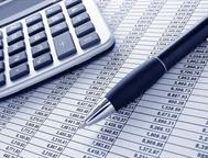 Ballpoint-ink-pen-and-calculator-on-a-financial-spreadsheet-statement-with-columns-of-numbers-for-an-accounting-budget-finance-reconciliation